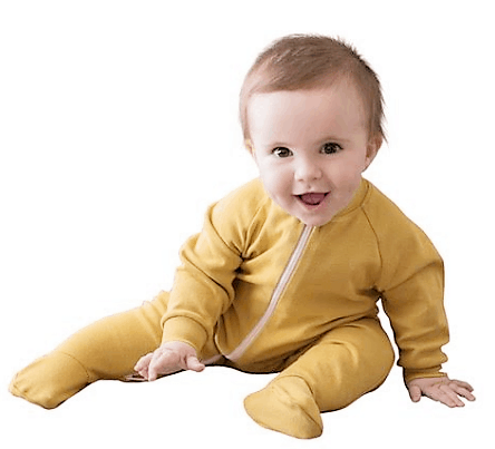 Castleware organic fleece footed pajamas. A photo of a happy baby in fleece footed pajamas.