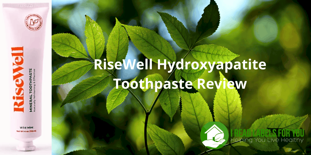 RiseWell Hydroxyapatite Toothpaste Review. A photo of Risewell toothpaste tube with green leaves in the background.