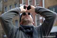 Me looking up while urban birding in London