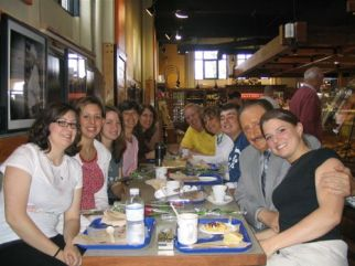The host families and benefactor Hermann Gruenwald are with the Life in a Jar cast in Montreal, Canada. The location is the popular breakfast spot, the St. Viateur Bagel Bakery.