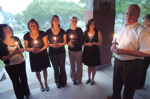 Members of 'Life in a Jar' honor Irena with a candle light ceremony.