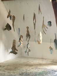 """""""Sea Mammal Conjuring"""" installation- tarred mulberry paper dimensions variable"""