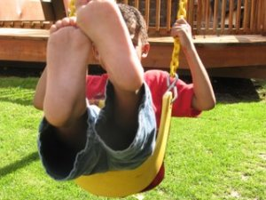 kid on swing - kid-on-swing