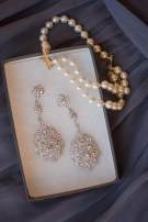 """pearl bracelet """"something borrowed"""" from my sister and earrings from a wedding recycle website (they're fake)"""
