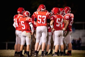 football players in a huddle
