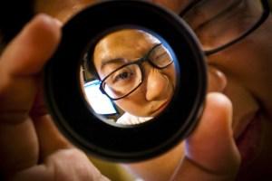 person looking through a lens