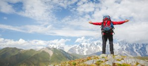 person standing on mountain