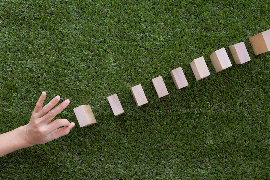 Person starting the domino effect