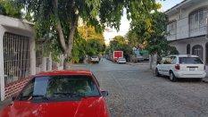 Note the cobblestone street