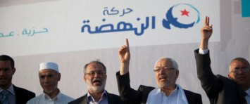 Rached Ghannouchi, leader of islamist party Ennahda (second/right), Sadok Chourou (co-founder of Ennahdha, second left), Abou Yaareb Marzouki, candidate for the Constituent Assembly (middle), during a rally of Ennahda