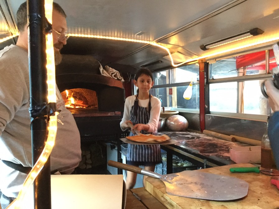 Cooking pizza on the Crust Conductor bus in Peckham with Chef Johnnie
