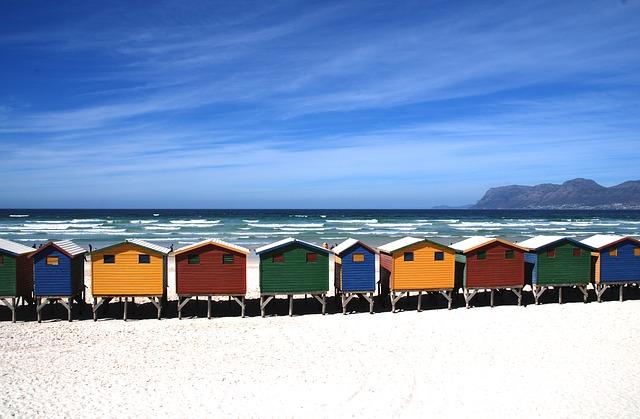 Beach houses view by the sea - travel insurance Australia