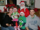Santa with 2 children and their parents