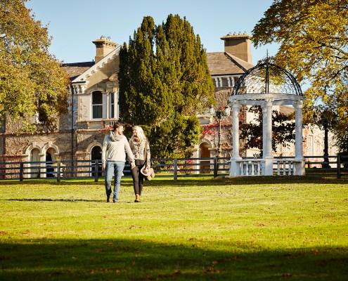 Couple walking at Lyrath Estate