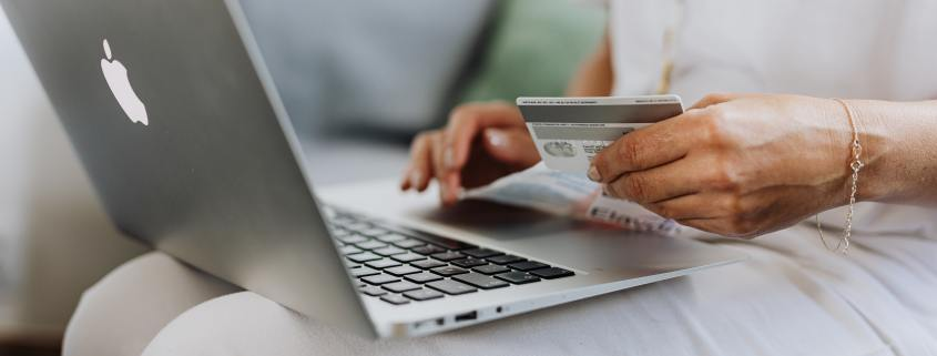 someone using a card to shop online