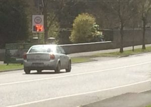 IMAGE: A speeding car passes a speed detected sign beside a narrow cycle lane in Ballina, Co Mayo.