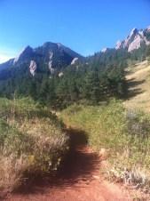 Trail running through the Flatirons in Boulder, CO.