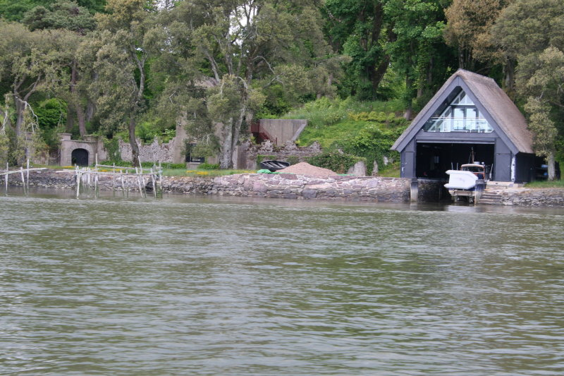 Ballynatray House lodge, salmon weir and thatched boathouse
