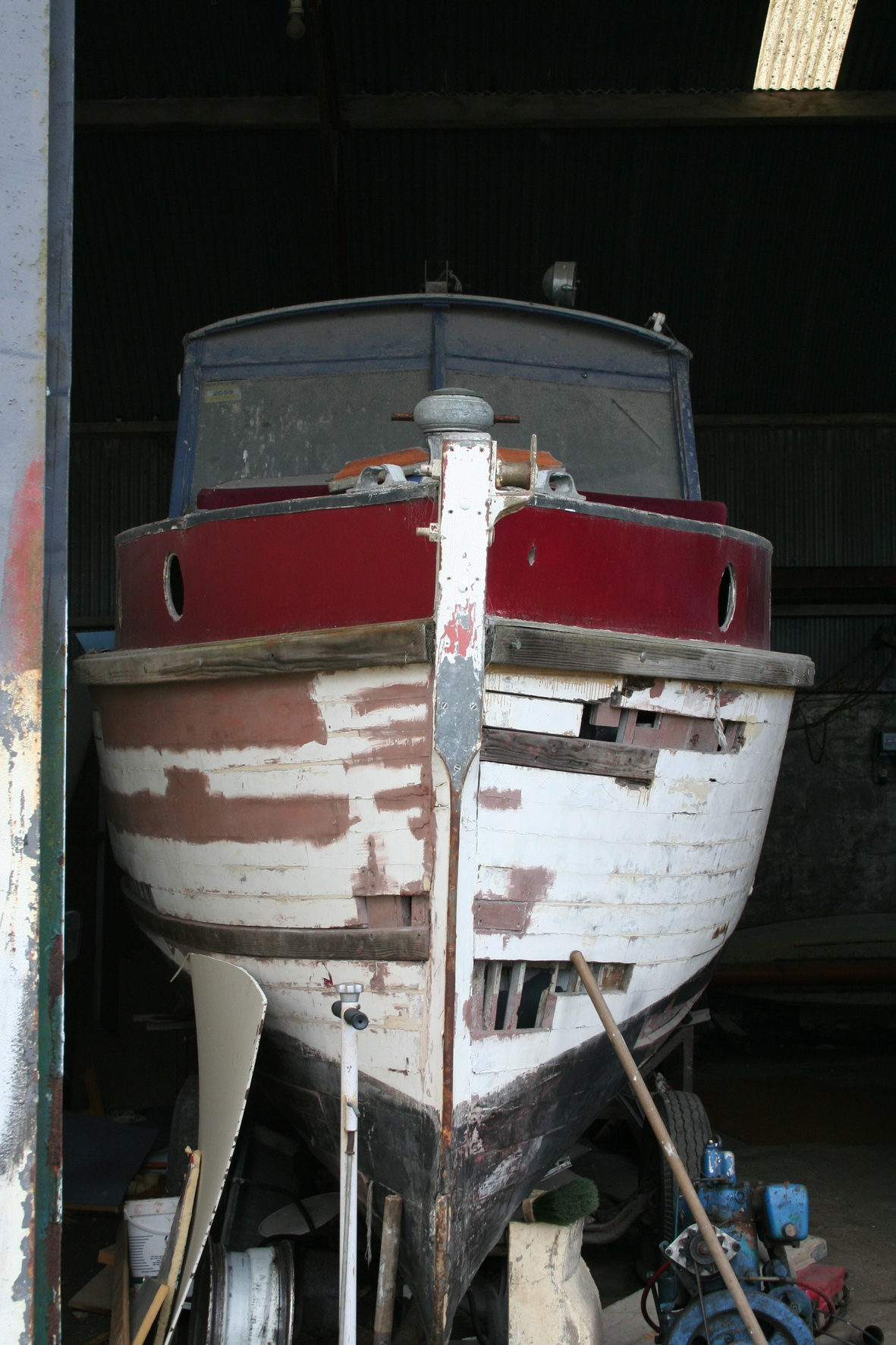 Cruiser in the shed (bows on)