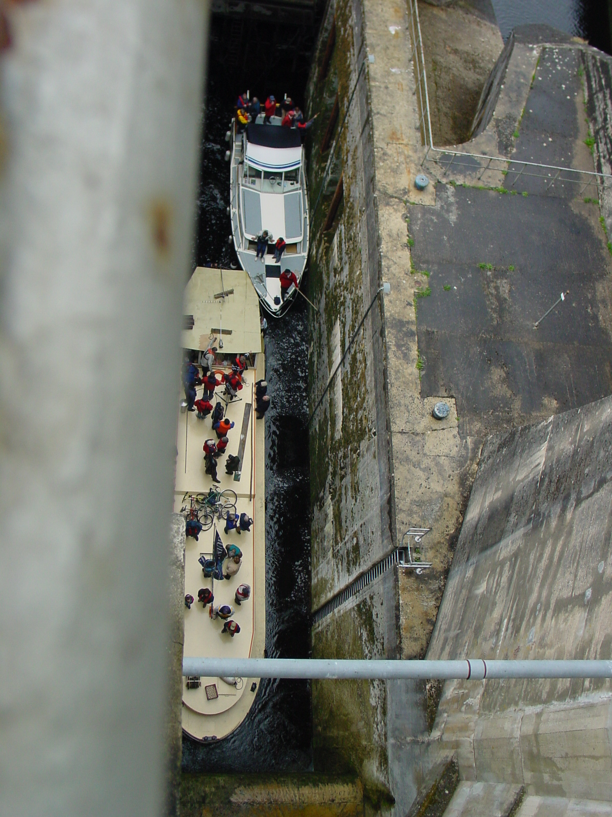 Boats at the bottom of the lower chamber in Ardnacrusha lock, seen from the top of the upper chamber