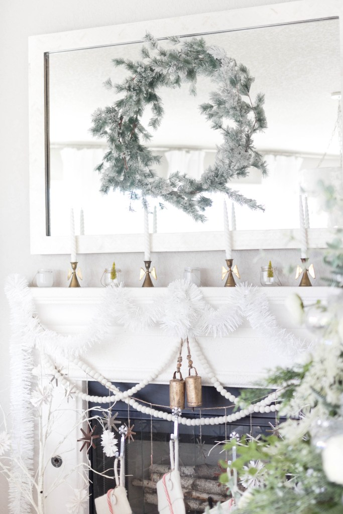 winter fireplace decorations-bohemain-glam-christmas-home-tour-iris-nacole-living-room-tourwinter fireplace decorations-felt stockings-bohemain-glam-christmas-home-tour-iris-nacole-living-room-tour