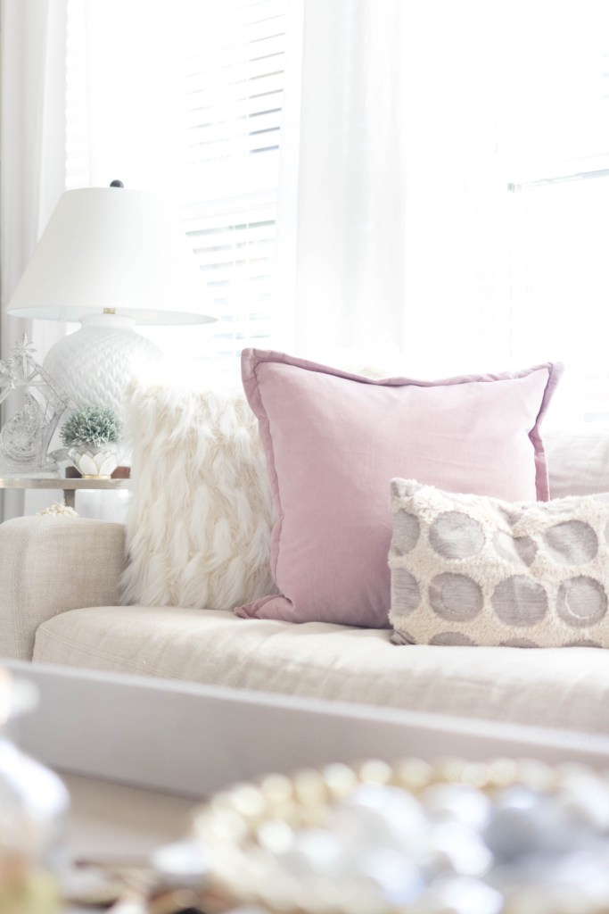 cozy mix of throw pillows-bohemain-glam-christmas-home-tour-iris-nacole-living-room-tour