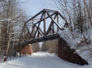 Image of snow-covered railway overpass bridge
