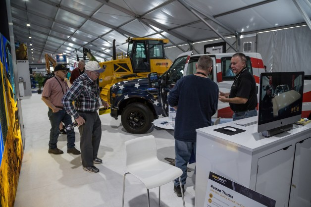 Steve Belden of Vehicle Reman talks to a visitor about Reman Trucks.