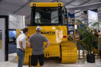 IronDirect Account Manager Chris Price (left) shows off the Shantui DH13K LGP dozer.