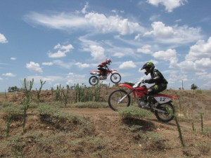 Dirt bike summer camp riders make jumps on Iron Horse Country Ranch acreage