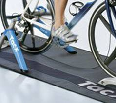 triathlon run training tips  -cyclists on a wind-trainer wearing cycling shoes.