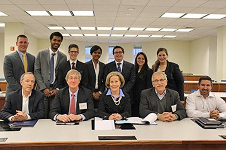 Law students and business students teamed up on Feb. 20 and 21, 2015, for the first UConn Law School-UConn Business School Joint Negotiation Competition. Marc Reich, second from right in the first row, was one of the competition judges.