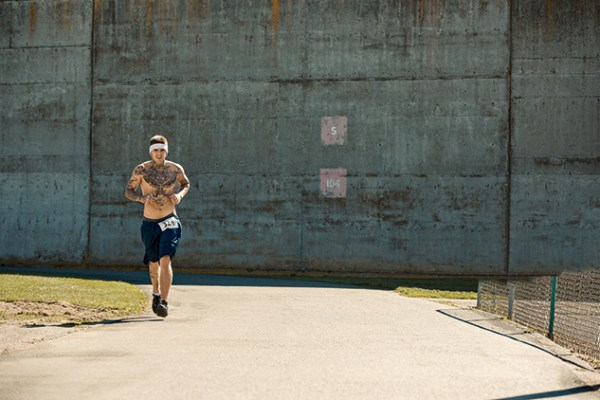 An inmate toughs out a lap around the yard, which, eight times a year, is converted into a 5K, 10K, and/or half marathon course on which convicts race outsiders