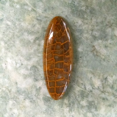 This interesting Agate cabochon has an Alligator skin pattern and measures 37 x 14mm.