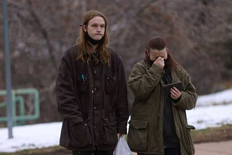 Sarah Moonshadow (right) burst into tears as she shared her experiences at the shooting range with her son Nicholas (left).