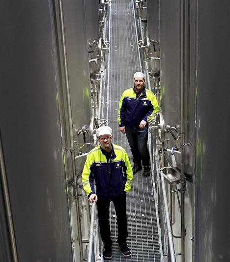 Teleworking is not possible in all jobs.  Hands are also needed in a highly automated brewery.  Tapio Kangas-Heiska and Heikki Vuokko pictured on a bridge between huge tanks.