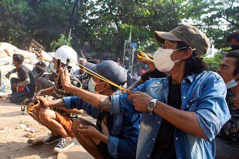 Protesters shot soldiers in raids in Yangon on Sunday.