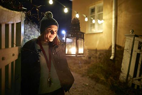 Henriikka Konki, who lives on the island of Seili over the winter, goes for an evening walk in the light of a lantern.