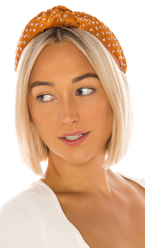 Lele Sadoughi Star Studded Silk Knotted Headband in Burnt Orange.