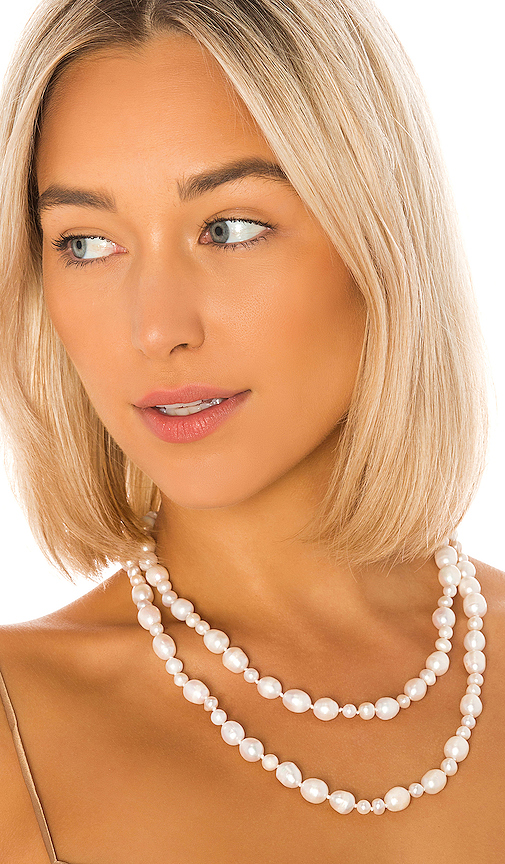 Lele Sadoughi Freshwater Pearl Rope Necklace in White.
