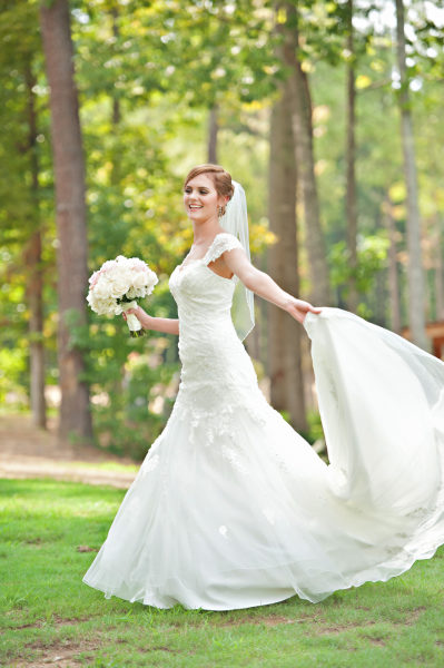 Bride dancing and twirling like a princess in her wedding dress from Bel Fiore