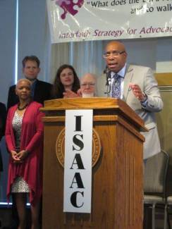 ISAAC President Elder Doug King welcomes the crowd at the banquet Saturday with clergy and leaders of the 25 ISAAC member congregations and organizations standing with him: (L to R) Wendy Fields, NAACP; Rev. Seth Weeldryeyer, First Presbyterian Church; Rev. Rachel Lonberg, People's Church; George Hebben, Kalamazoo Friends Meeting.