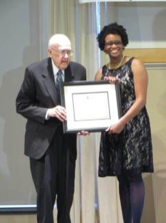 "Rev. Robert Rasmussen receives the Lifetime Achievement Award from ISAAC executive director Dr. Charlae Davis, for responding to the verse ""Let the poor and needy praise thy name"" (Psalm 74:21) in many ways, such as the soup kitchen he began at North Presbyterian Church that grew into Loaves and Fishes."