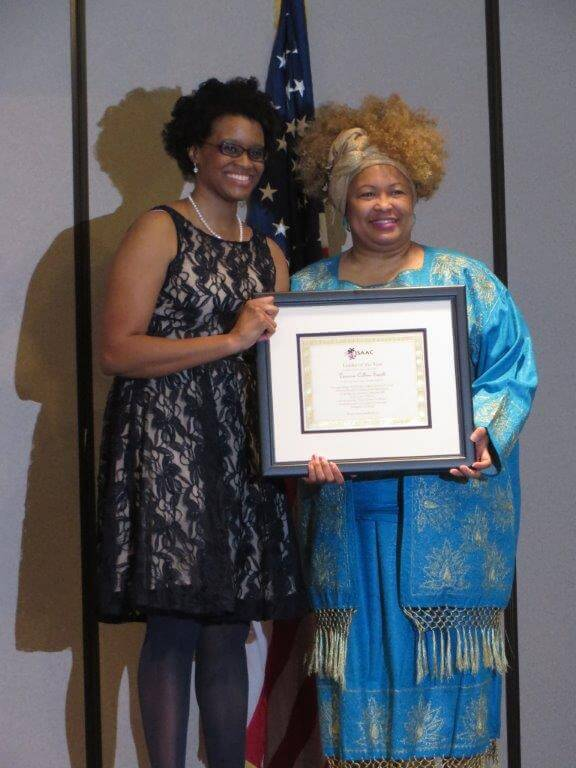 """Dr. Charlae Davis presents Ms. Venessa Collins-Smith with ISAAC Leader of the Year Award for creating """"Future Leaders for Peace"""" as part of ISAAC's work on Youth Violence Prevention."""