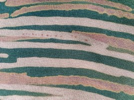 Spots of dye on the surface of waxed areas transfer to silk surface during steaming