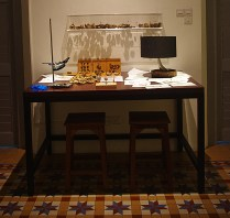 The Lab bench, with samples of seeds to sort, a viewing case, ma magnifying glass and drawing tools, a zoetrope demonstrating the seeds exploding and some sketches, an abstract of the work in progress...