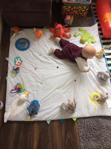 This is the clock game that we do to help with tummy time