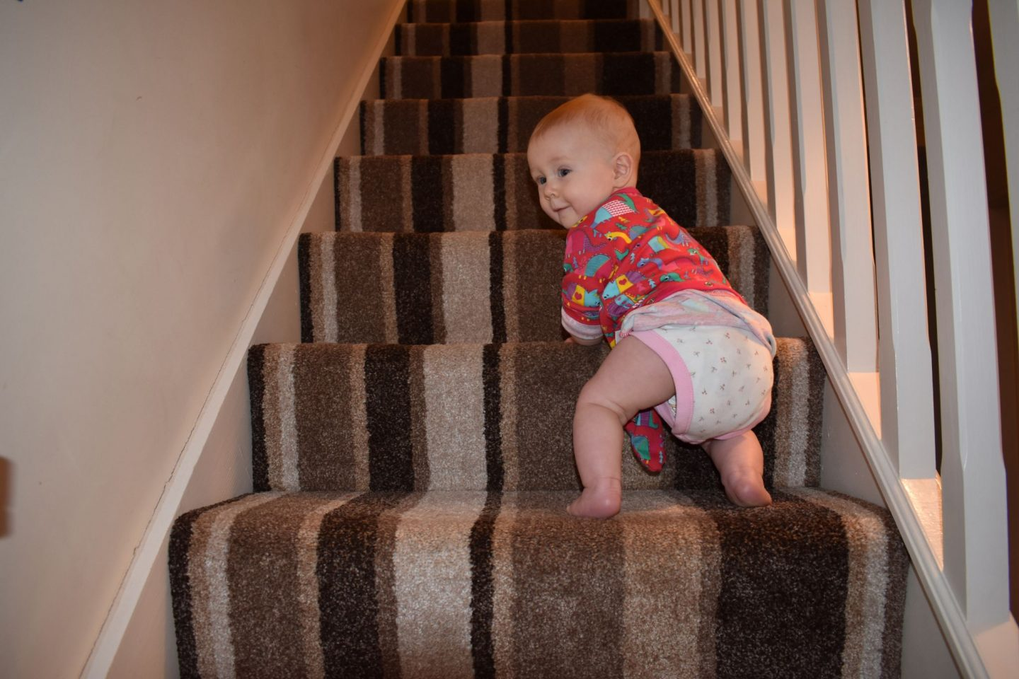 Our baby climbing the stairs
