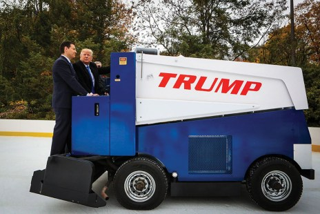 """Donald Trump, president and chief executive of Trump Organization Inc. and 2016 Republican presidential candidate, right, rides on an ice resurfacer during a Bloomberg Television interview with Mark Halperin, co-host of """"With All Due Respect,"""" during an interview at Wollman Rink in Central Park in New York, U.S., on Monday, Nov. 2, 2015. Trump said being a businessman and fighting a war is """"all the same because it has to do with efficiency it has to do with common sense."""" Photographer: Chris Goodney/Bloomberg via Getty Images"""
