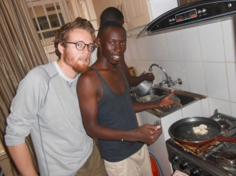 Feston and Drew making tofu with Placide in the background. I will admit that I wasn't too much of a help in the process.